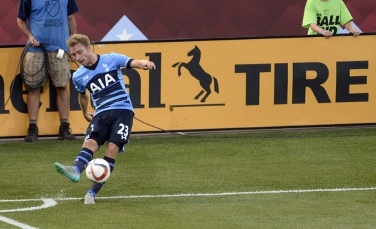 Jul 29, 2015; Denver, CO, USA; Tottenham Hotspur midfielder Christian Eriksen (23) makes a corner kick during the first half of the 2015 MLS All Star Game against the MLS All Stars at Dick's Sporting Goods Park. Mandatory Credit: Ron Chenoy-USA TODAY Sports